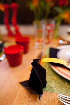 ***Our DIY portion of the table design: - Origami Crow (directions from the internet) including a post-it note in the bird's mouth ready to write the guest's name on. - Placemats 'Grass' Paper from Michaels Unique Settings, Crow, Earthy, Decorative Items, Origami, Grass, Vibrant, Internet, Note