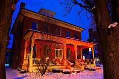 Orchard Park Historical Society Museum in Red & Blue: ...  the blue hour series from Orchard Park, NY continues with a dusk photograph of the Orchard Park Historical Society Museum housed in the Jolls House. Winter is what Buffalo and its south towns are known for and snow, the essential ingredient is added to the classic blue hour combination of deep blue sky combined with artificial illumination. Watching a day turn into night ...