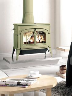 We've got a wide range of stove paints in store that make it easy for you to customize a hearth just like this! Stove Paint, Wood Pellet Stoves, Urban Cottage, Vintage Stoves, Wood Burning Fires, Front Rooms, Log Burner, Herd, Fireplace Mantle