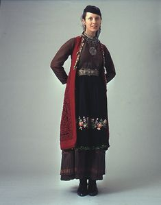 """Early 20th c. woman's costume from the Zagori villages group. The oldest part of the costume is the sleeveless long coat known as """"flokata"""" with a complicated red cord embroidery.  Size   Date Early 20th c."""