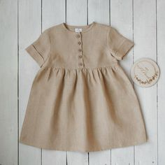 A childrens dress made of linen long sleeve, without buttons. The color of the dress is melange. Actual color may vary from picture due to computer settings. Baby Outfits, Little Girl Dresses, Toddler Outfits, Kids Outfits, Girls Dresses, Dress Girl, Baby Girl Fashion, Toddler Fashion, Fashion Kids