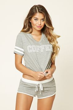 """A set of heathered knit PJs featuring a tee with a V-neckline, short varsity striped sleeves, and a """"Coffee"""" graphic on the front, as well as a pair of shorts with a contrast elasticized drawstring waist and a contrast dolphin hem."""