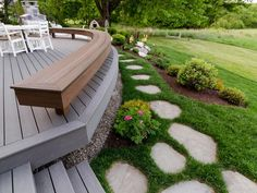 A stone pathway, fashioned from locally quarried ledgestone, connects the back deck to the patio area.