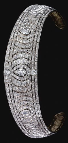 A Belle Epoque diamond kokoshnik tiara, circa 1910. Designed as a series of radiating scrolls surrounding three principle pear-shaped diamonds set with circular-, rose-cut and cushion-shaped stones, framed by two lines of similarly-set diamonds. purchased during the 1930s by Mervyn Horatio Herbert, Viscount Clive, for his wife Vida Cuthbert, daughter of Capt James Cuthbert DSO. #BelleÉpoque #tiara