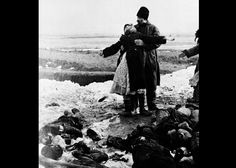 Parents find the body of their dead son near Kerch City, on the Kerch Peninsula in eastern Crimea, on April 4, 1942. Soviet and German forces had been fighting across the peninsula beginning in late 1941. The decisive Battle of the Kerch Peninsula took place in May, 1942, with the Germans taking control of the region. (AP Photo) #