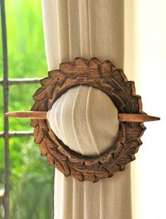 Wooden Curtain Holder. I love this, however, I would blunt the ends. Don't need anyone spearing themselves on the drapes.