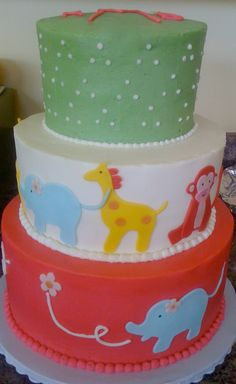 Monogram and animal cake for a baby shower