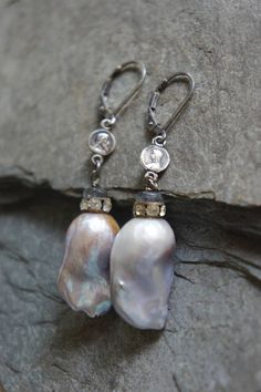 Just amazing large Baroque pearl earrings. The pearls themselves have gorgeous color and lovely shape. They are hand wired with a vintage rhinestone set bead and labradorite gemstone bead at the top. Then they are connected to vintage rosary links from an antique french rosary.