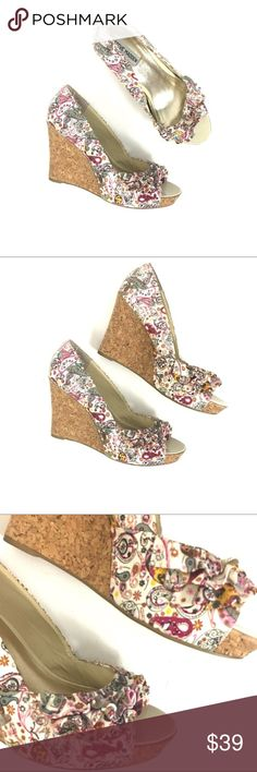 Steve Madden sz 11 CAMIO ruffle floral cork wedge* Steve Madden sz 11 CAMIO ruffle floral cork wedges  Gently used/Worn twice. Size 11. Some fraying to the edges on the back of the heel. peep toe floral wedges with a cork wedge. Cute ruffle accent on toe Pink, purple and yellow paisley print.  Patent shoes  B311 Steve Madden Shoes Wedges