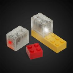 LED Construction Brick Brites from thinkgeek: Add lights to your LEGOs! Motion activated light up construction bricks, compatible with major toy brick brands