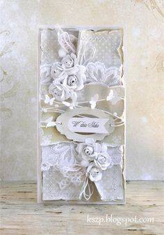 beautiful white layers... love the string with the butterflies
