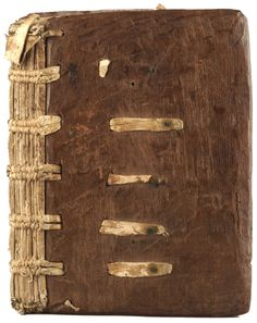A Medieval English Binding With Thongs Laced Into Oak Boards