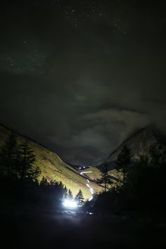 Runners light up the night above Lac Combal during the Ultra-Trail du Mont-Blanc. Photo: Kirsten Kortebein