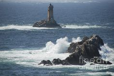 La vielle lighthouse along the Brittany coast, France.