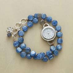 "double wrap bracelet watch Item No. 65645 	$158.00 Our strand of kyanite and labradorite wraps twice. The watch's face is mother of pearl, its case sterling silver to match the toggle clasp. Quartz movement. Exclusive. Handmade in USA. Fits 7"" to 7-1/2"" wrists; 7/8"" dia. case."