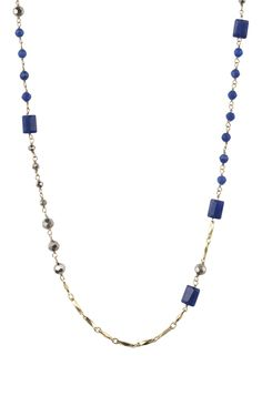 the Millie necklace has scattered rectangular and round semi-precious dyed jade stones with faceted glass beads on a delicate gold plated brass chain. Perfect for layering.
