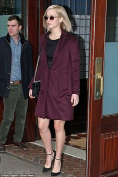 Stylish look: The 25-year-old actress wore a luxurious burgundy coat for the outing