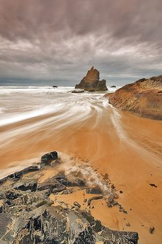 Seaside, Oregon Rocks and Surf  Yep!One of my favorite spots to spend a summer day! Love it! ;o)