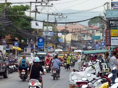 The busy Main st in Chewang Beach, Koh Samui, Thailand  #Chewang #beach #KohSamui #Thailand #road #scooter #busy #wires #fun #awesome #holiday #honeymoon #cheapcheap