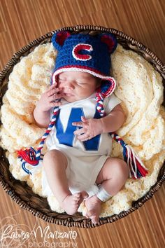 Chicago Cubs W onesie. I realllllly need to learn to crochet (or however you spell that)
