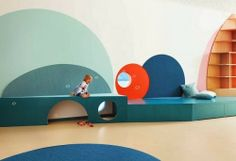 Kita Hisa designed by Baukind in Berlin. Colourful circles stretch across, walls, ceilings and floors.