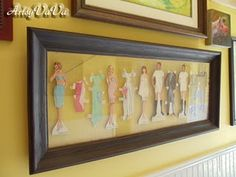 This is awesome in so many ways. Framed paper dolls. How cute in a little girls bedroom?