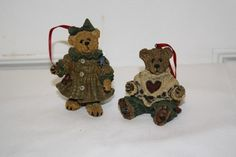 """Boyd's set of 2 bear ornaments: measurements are approx: boy 2 1/4"""" x 2"""" x 2"""" from 1997, girl 3.5"""" x 2"""" x 1 3/4"""" from 1997 limited edition $12.50"""