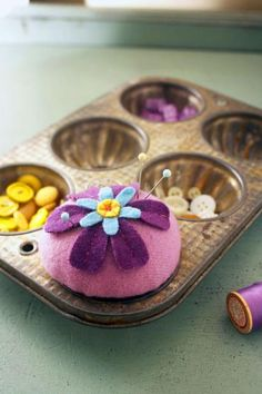Store buttons, pins, and other small quilting supplies in decorative containers, such as antique muffin tins.