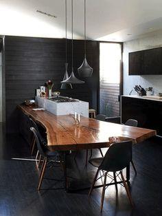 Reclaimed wood table, painted black floor