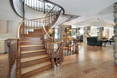 This gorgeous staircase spirals up to the second floor and down to the basement with hardwood treads and railings. Description from pinterest.com. I searched for this on bing.com/images