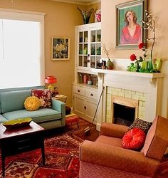 Teal couch, red rug, green accents, beige wall color.  By Carmela.