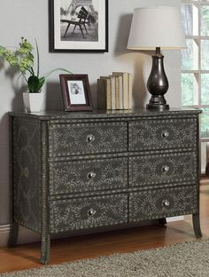 Elian Chest - great for meshing your refurbished wooden pieces with the leather floor, chandelier, and headboards;)