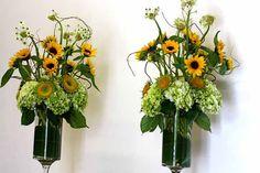 Sunflower and green hydrangea arrangements by Sebesta Design, wedding florist in Philadelphia