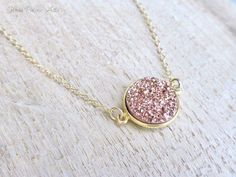 This druzy necklace sparkles and shines like a twinkling star in the light! - Rose gold colored druzy pendant is bezel set in 14k gold vermeil - Druzy pendant measures 20mm including loops - Made with