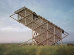 A bird observation tower designed by gmp Architects located on a natural bird reserve in Heiligenhafen, Germany.