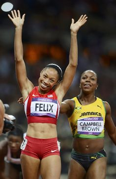 Day 14 - Allyson Felix (L) of the U.S. is congratulated by Jamaica's Veronica Campbell-Brown after winning the women's 200m final during the London 2012 Olympic Games at the Olympic Stadium August 8, 2012. REUTERS/Dylan Martinez