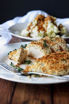 Easy baked Parmesan and herb crusted chicken breasts are baked in the oven with panko breadcrumbs, Parmesan cheese, Italian seasoning and sage.