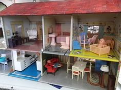 I found it! Can't believe I found a photo of my tin doll house that I loved so much. I had so much fun with it.