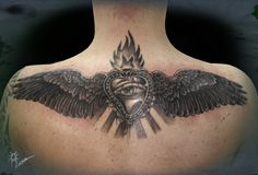 ...silver heart and raven wings...on back...
