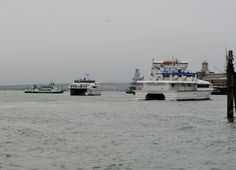 https://flic.kr/p/Rjb1HD   Portsmouth Harbour   Wight Ryder 1 is about to arrive at the Harbour pontoon to drop of the passengers whilst Wight Ryder 2 awaits to take over the service for the next departure, also in the photo is Wight Sun at rest at the hulk in the harbour while Spirit of Portsmouth heads towards Portsmouth.