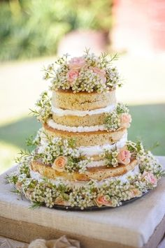This beautiful naked cake with spring flowers is a great inspiration for a trendy spring wedding; http://onthegobride.com/2015/05/rustic-windsor-castle-farm-wedding