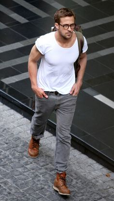 glasses. white t shirt. grey jeans.