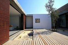 Built by Pedro Ferreira Pinto in Comporta, Portugal Casa do Pego is a stunning single floor house located 400 meters from Pego beach, near Comporta. This luxury design v. Prefab Cottages, Patio Design, House Design, Casa Patio, Wood Cladding, Lawn And Landscape, Vacation Home Rentals, House Rentals, Boutique Homes