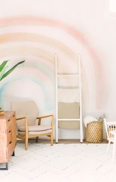 Brighten your nursery or playroom with the Elsi rainbow wallpaper mural. This retro rainbow wallpaper features a smooth, matte finish and unique style.