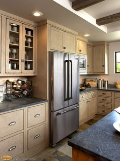Natural cabinets with stainless steel appliances