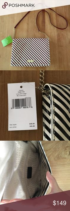 """NWT Kate Spade Vionette striped clutch NWT Kate Spade Vionette black cream stripe clutch with chain strap leather crossbody. Length 9"""", height 7"""", drop 22"""", width 1"""". Magnetic Snap opening. Kate Spade embossed signature fabric lining. Interior has zip compartment and six credit card slots. Retails for $228. kate spade Bags"""