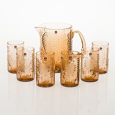 "OIVA TOIKKA - Glass pitcher and tubmlers from the ""Flora"" series designed manufactured by Iittala, Finland. - Produced for the Japanese market. Height of the pitcher cm, height of the tumblers cm."