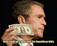 Bush holds up a page from the Republican bible.