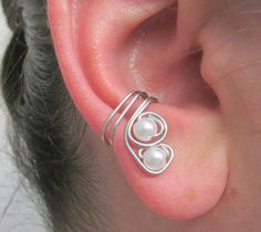 This no pierce cartilage cuff is made with copper based silver tone artistic wire and 2 acrylic pearls. The double pearls are nestled in the wire to make a great wedding accessory either for brides or bridesmaids!  Ear wraps are a great alternative for people who cannot have pierced ears and kids or teens who don't want to deal with the pain of piercing or the upkeep and maintenance of new piercings! $5.50
