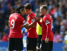 Radamel Falcao shakes hands with Manchester United captain Wayne Rooney and Ander Herrera